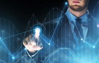 businessman touching virtual charts projection