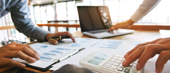 Business executives analysis data document and calculating about