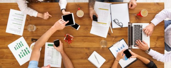Group of busy business people working in office, top view